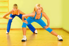Beautiful women exercising. In fitness club royalty free stock photography