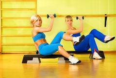 Beautiful women exercising. In fitness club Stock Images