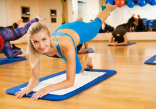 Beautiful women exercising. In fitness club stock photo