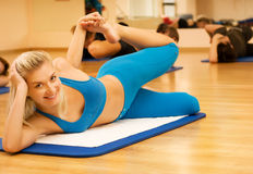 Beautiful women exercising. In fitness club royalty free stock image