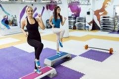 Beautiful women exercising aerobics Stock Photography
