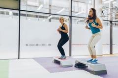 Beautiful women exercising aerobics Stock Image