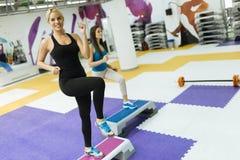 Beautiful women exercising aerobics Royalty Free Stock Photo