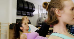 Beautiful women exercising in fitness studio stock footage