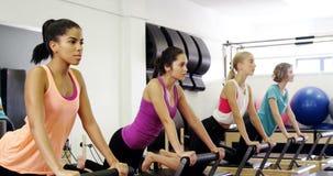 Beautiful women exercising in fitness studio