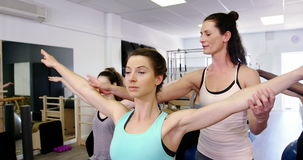 Beautiful women exercising in fitness studio stock video footage