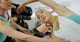 Beautiful women exercising in fitness studio stock video