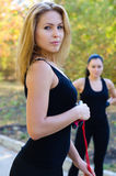 Beautiful Women exercising outdoors Stock Photos