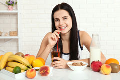 Beautiful women exists with pure skin on her face sitting at a table and eat breakfast. Asian woman eating healthy food at breakfa Stock Images