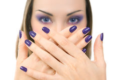 Beautiful women eyes with stylish make-up and hands with purple Stock Photography