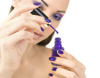 Beautiful women eyes with stylish make-up and hands with purple Stock Photo