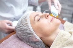 Beautiful woman with a facial mask at a beauty salon royalty free stock photo