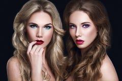 Beautiful Women Fashion Models. Haircare Concept Stock Photo