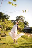 Beautiful women In the field of flowers and sunshine. In the morning royalty free stock images
