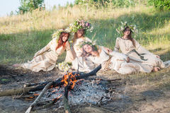 Beautiful women with flower wreath near bonfire Royalty Free Stock Images
