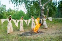 Beautiful women with flower wreath near bonfire Royalty Free Stock Photography