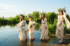 Beautiful women with flower wreath in water Royalty Free Stock Photography