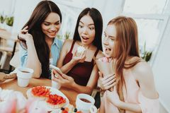 Beautiful Women and Friend Eat. and Play with Smartphone. Smartphone with Girls in Day 8 March. Women Play with Smartphone. Young. Girl Play Smartphone stock photo