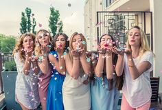 Beautiful Women Friends Having Fun At Bachelorette Party. Girls Party. Beautiful Women Friends on the balcony Having Fun At Bachelorette Party. They are blowing royalty free stock photos