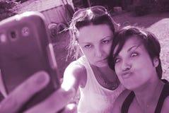Beautiful women friends selfie Stock Image