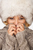 Beautiful women with fur hat thickly clothed Royalty Free Stock Images