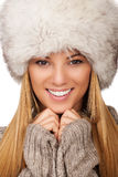 Beautiful women with fur hat thickly clothed Royalty Free Stock Photos