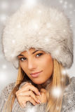 Beautiful women with fur hat and winter clothing Stock Image