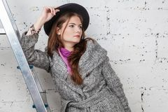 Beautiful women in gray coat royalty free stock photography