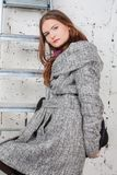 Beautiful women in gray coat royalty free stock images