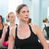 Beautiful women group in a row at aerobics class Royalty Free Stock Image