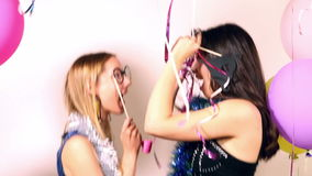 Beautiful women having fun dancing using props in party photo booth stock video