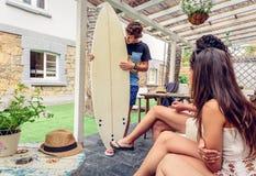 Beautiful women having fun in a surf class Stock Photo