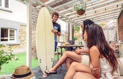 Beautiful women having fun in a surf class Royalty Free Stock Photo