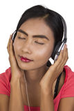 Beautiful women with headphones. Royalty Free Stock Images