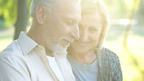 Beautiful woman in his 60s tenderly looking at retired male, happy aged couple. Beautiful women in his 60s tenderly looking at retired male, happy aged couple royalty free stock photo