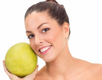 Beautiful women holding a big grapefruit in hands Royalty Free Stock Image