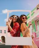 Beautiful women holding a blank photo frame royalty free stock image