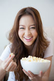 Beautiful women holding a bowl of popcorn Royalty Free Stock Images