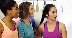 Beautiful women interacting with each other in fitness studio stock video footage