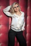 Beautiful women on leather background Stock Photos