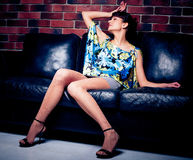 Beautiful women on leather sofa Royalty Free Stock Image