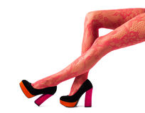 Beautiful women legs in red tights and high heel shoes Stock Photography