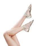 Beautiful women legs in sandals up in the air Royalty Free Stock Photos