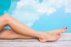 Beautiful women legs by the swimming pool Stock Photo