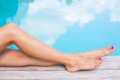 Beautiful women legs by the swimming pool Stock Photo