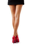 Beautiful women legs. Beautiful woman legs in red high heel shoes from behind Royalty Free Stock Images