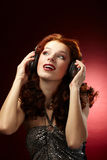 Beautiful women listening musi Stock Photo