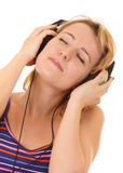 Beautiful women listening music in headphones Stock Images