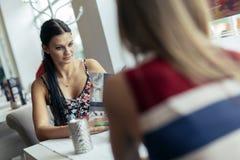 Beautiful women looking at menu in restaurant Stock Image