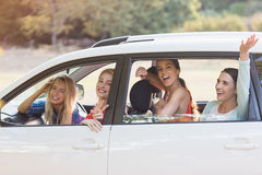 Beautiful women looking out from car window stock photo